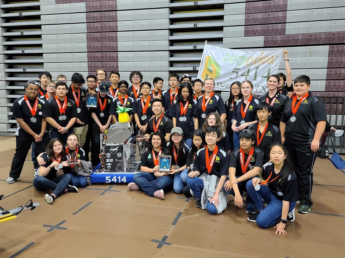 Pearland ISD Pearadox Robotics team with their robot at a competition